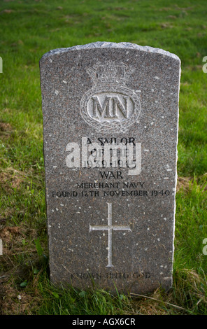 vertical portrait photo of a grave stone for an unknown sailor of the merchant navy that died in world war two - Stock Photo