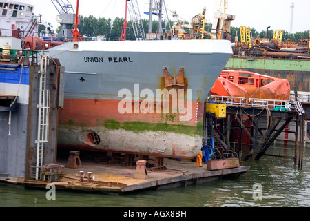 Container ship in dry dock at the Port of Rotterdam Netherlands - Stock Photo