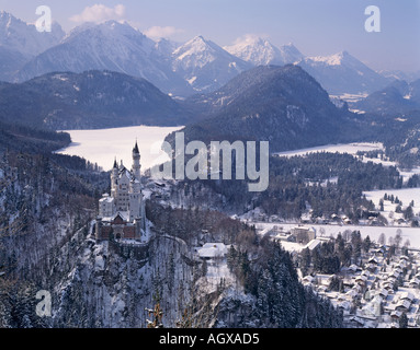 The castle Neuschwanstein in front of the snow vovered Alpsee near Fuessen Germany - Stock Photo