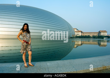 Young chinese model infront of the national theatre opera for Beijing opera house architect