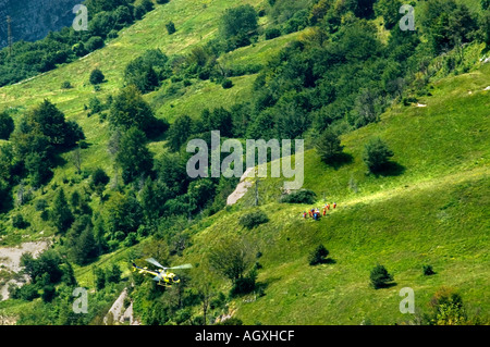 Helicopter rescue save people lost in mountain italy friuli alpine- region of friuli venezia giulia – italy - Stock Photo