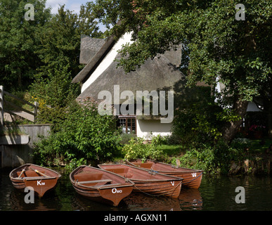 Bridge Cottage and rowing boats for hire at Historic Flatford in Suffolk England - Stock Photo