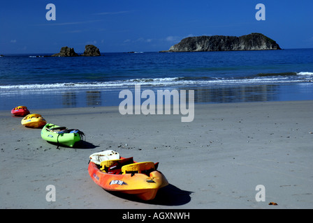Kayak at beach south of Quepos at entrance to Manuel Antonio National Park Pacificc Coast of Costa Rica - Stock Photo