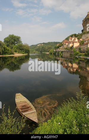The Dordogne River at Beynac at Cazenac with Traditional Boat in Foreground - Stock Photo