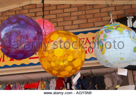 Inflatable toys in hanging display in fropnt of shop in Skegness, - Stock Photo