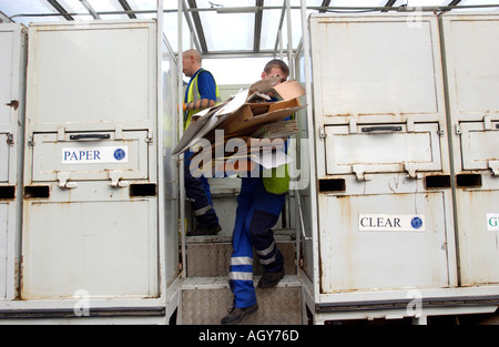 Council worker sorting rubbish in a collection lorry Britain UK - Stock Photo
