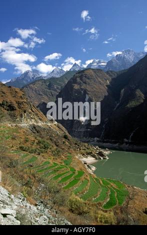 China Yunnan Tiger Leaping Gorge Jinshu River entering gorge - Stock Photo