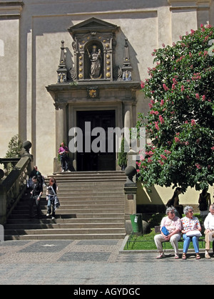 Group of tourist in front of Our Lady Victorious church P M Vitezna or The Infant Jesus of Prague Church Prague - Stock Photo