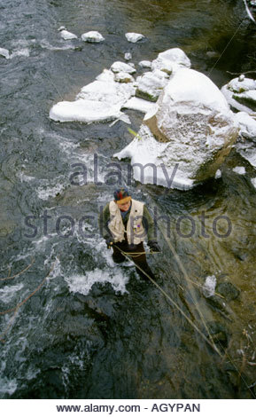 Overhead view of fly fisherman casting in stream - Stock Photo