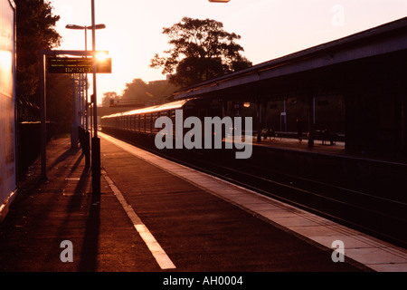 Railroad station at sunrise - Stock Photo