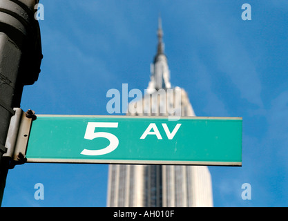 Fifth Avenue street sign with the Empire State Building behind, Manhattan, NYC, New York City, NY, USA - Stock Photo