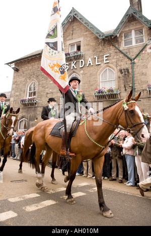Traditional Scottish event Langholm Common Riding Cornet recieves town standard in front of town Hall Scotland UK - Stock Photo