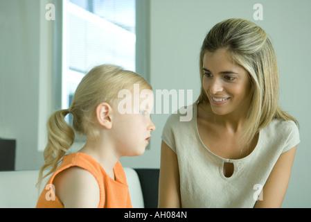 Woman listening to little girl - Stock Photo