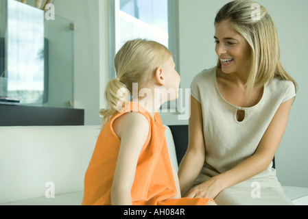 Mother talking to little girl - Stock Photo