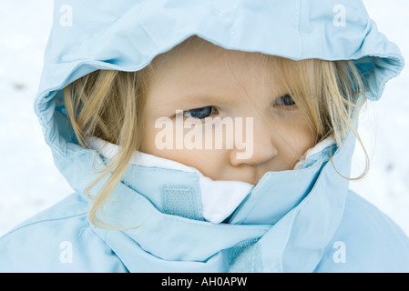 Toddler girl wearing winter coat, close-up, portrait - Stock Photo