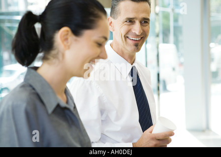 Two business associates laughing - Stock Photo