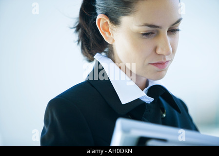 Businesswoman looking at file, cropped view - Stock Photo