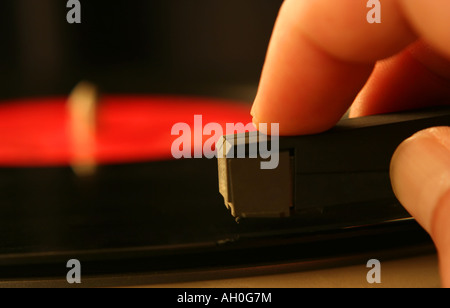 Close up of hand on a turntable - Stock Photo