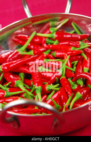 Red bird's eye chillies in a bowl. - Stock Photo