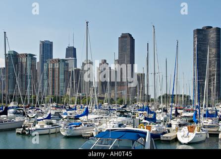 LAKEFRONT Chicago Illinois Sailboats docked in DuSable harbor on Lake Michigan city skyline Hancock building - Stock Photo