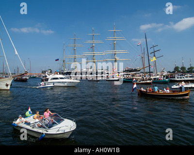 Crowded water at the sail Amsterdam 2005 tall ship event with the famous Russian navy clipper Kruzenshtern in the - Stock Photo