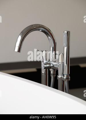 Modern design chrome steel bath tap faucet with design showerhead on edge of bath