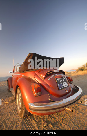 An early-1970s Volkswagen Beetle cabriolet on a beach. 2007. - Stock Photo