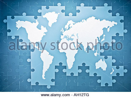 Symbolic puzzle pieces combined with map of the world - Stock Photo