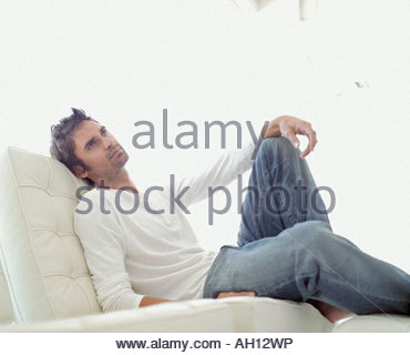 A man relaxing in a comfy seat - Stock Photo