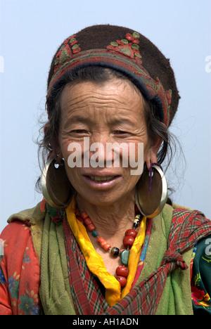 A Tamang woman smiles as she greets a stranger, Tamang Heritage trail, Nepal - Stock Photo