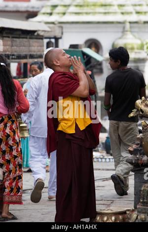 Tibetan buddhist monk praying at Swayambhu stupa, Nepal, Kathmandu - Stock Photo