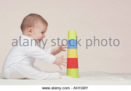 A baby playing with building toys - Stock Photo