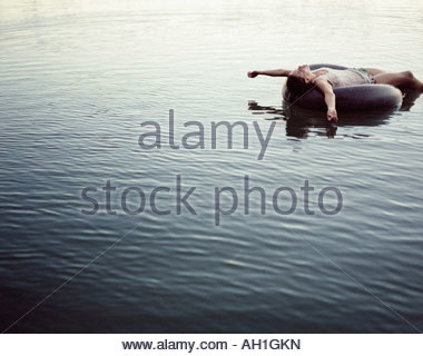 A woman relaxing in the water - Stock Photo
