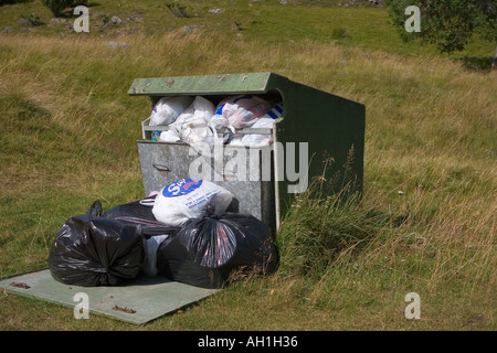 Rubbish bin overflowing Cairngorms National Park, Scotland, UK - Stock Photo