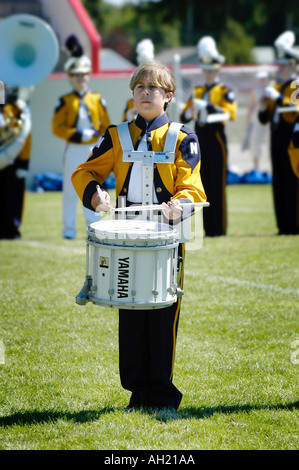 High School Marching Band Plays Music At Football Game - Stock Photo