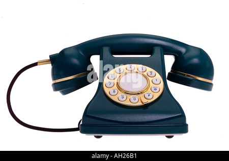 replica green and gold telephone silhouetted on white background - Stock Photo