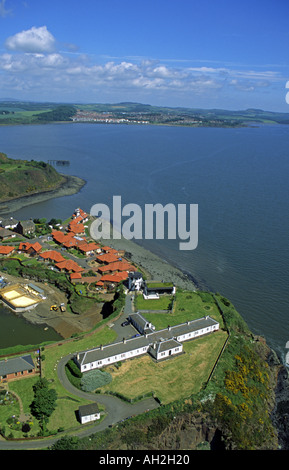 View across the Coast Guard Station in North Queensferry to Dalgety Bay from the Forth Rail Bridge - Stock Photo