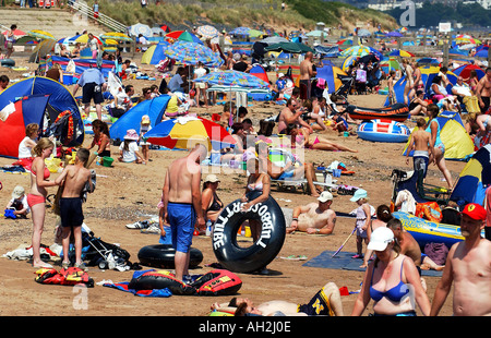 Sunseekers pack the beach at Dawlish Warren Devon on a hot Summer's day - Stock Photo