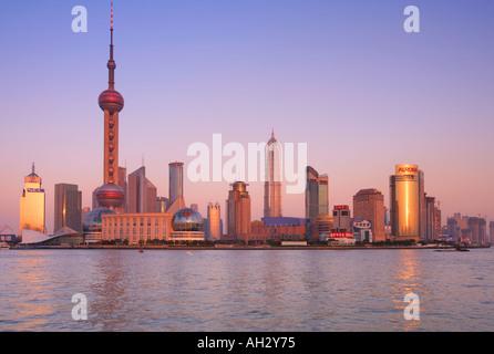 Shanghai Skyline viewed over Huangpu River China - Stock Photo