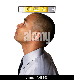 African American Man with level on head - Stock Photo