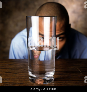 African American man with glass of water - Stock Photo