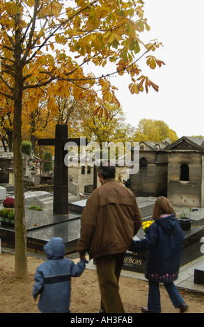 man and his children in Père Lachaise cemetary Paris France - Stock Photo