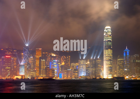 Hong Kong Skyline with evening sound and light show from Kowloon - Stock Photo