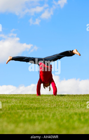 Girl doing a handstand - Stock Photo