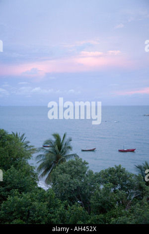 Fishing boats at sunset over Phala Beach located 36 km from Rayong Thailand - Stock Photo