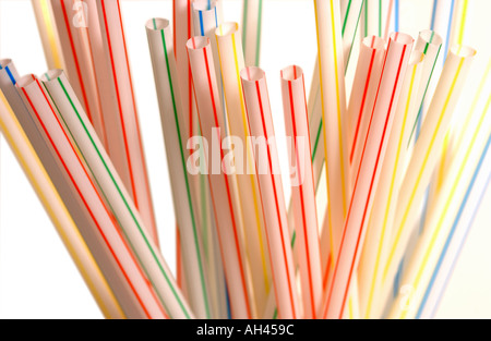 Single use non recyclable plastic coloured drinking straws - Stock Photo