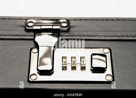Combination lock on a briefcase - Stock Photo