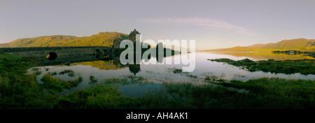 Eilean Donan Castle and mirror reflection in lake, Loch Duich, Dornie, Scotland - Stock Photo