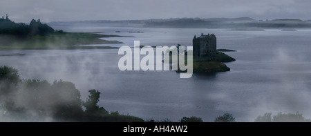 rainfall and fog over Stalker Castle, Scotland - Stock Photo