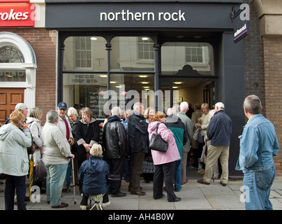 Investors Queue Outside a Branch Of The Northern Rock Building Society - Stock Photo